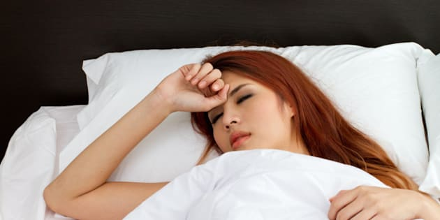 sick woman on bed  symptom of...