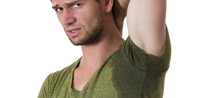man with hyperhidrosis sweating ...