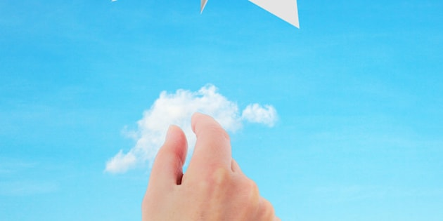 hand throwing paper airplanes...