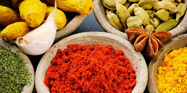 colorful mix of spices on stone ...