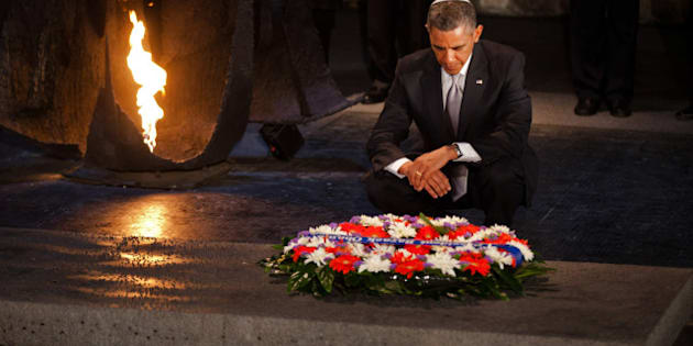 JERUSALEM, ISRAEL - MARCH 22:  (ISRAEL OUT)  U.S. President Barack Obama pays his respects in the Hall of Remembrance in front of Israel's President Shimon Peres, Israel's Prime Minster Benjamin Netanyahu, Chairman of the Yad Vashem Directorate Avner Shalev and Rabbi Yisrael Meir Lau after marines layed a wreath on his behalf during his visit to the Yad Vashem on March 22, 2013 in Jerusalem, Israel. This is Obama's first visit as president to the region and his itinerary includes meetings with the Palestinian and Israeli leaders as well as a visit to the Church of the Nativity in Bethlehem. (Photo by Uriel Sinai/Getty Images)