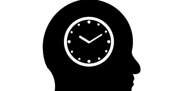 time symbol in a man's head...