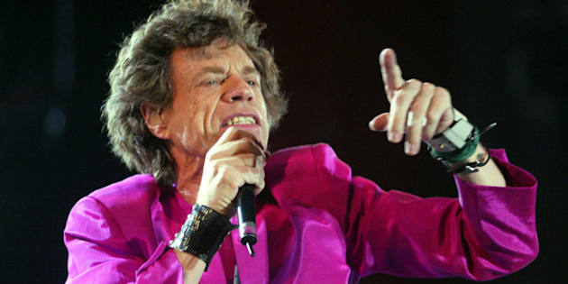 TORONTO, CANADA - JULY 30:  Mick Jagger of the Rolling Stones performs during the SARS relief concert held at Downsview Park July 30, 2003 in Toronto, Canada. An estimated 490,000 fans showed up for the daylong music festival headed by the Rolling Stones.  (Photo by Donald Weber/Getty Images)