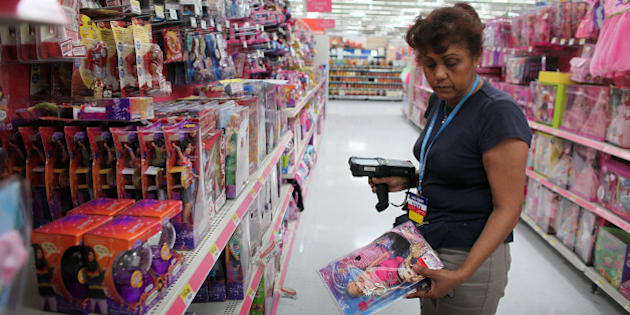 POMPANO BEACH, FL - OCTOBER 08:  Wal-Mart employee Yedira Hernandez restocks the shelves in the toy department October 8, 2009 in Pompano Beach, Florida. Wal-Mart stores, Inc. announced recently that it would be bringing back its $10 toys section in all stores as they gear up for the holiday shopping season and will expand its $10 holiday assortment this year to more than 100 toys.  (Photo by Joe Raedle/Getty Images)