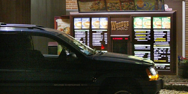 CHICAGO - JULY 15:  A driver places a drive-up order at a Wendy's fast-food restaurant July 15, 2004 in Chicago, Illinois. Fast-food restaurant chains are stepping up efforts to attract late-night eaters.  (Photo by Tim Boyle/Getty Images)