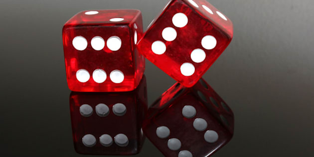 two red dice on black gloss...