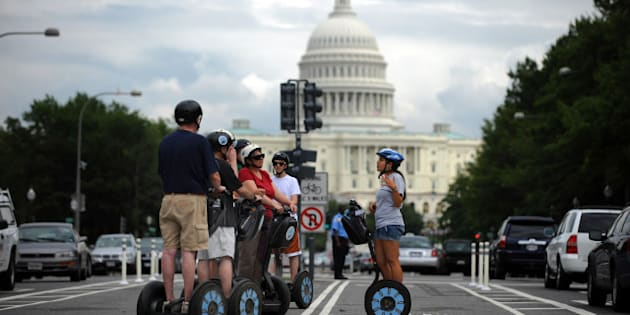 A Segway tour group stops on the new Pennsylvania Avenue bicycle lanes near the US Capitol for some narration from their guide on August 2, 2010 in Washington.   AFP PHOTO/Tim Sloan (Photo credit should read TIM SLOAN/AFP/Getty Images)