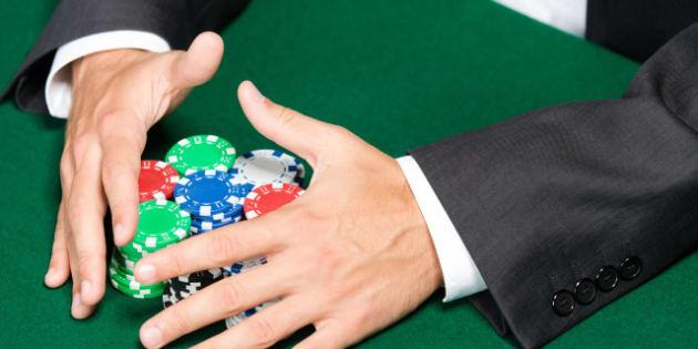 poker player raking a big pile...