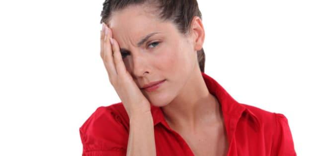 young woman having ocular pain