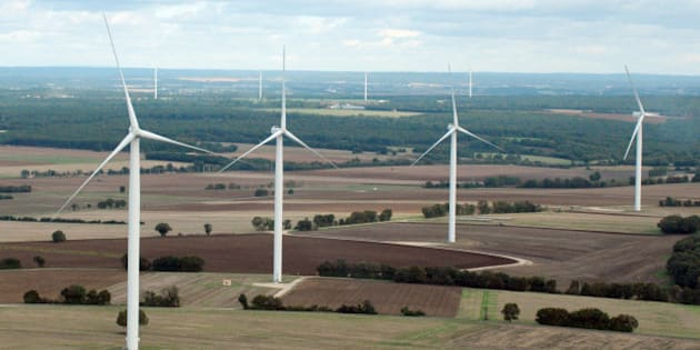 Aerial view taken on October 10, 2012 shows wind turbines in the countryside between Poitiers and Angouleme. AFP PHOTO ERIC PIERMONT        (Photo credit should read ERIC PIERMONT/AFP/Getty Images)