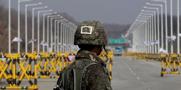 PAJU, SOUTH KOREA - APRIL 09:  A South Korean soldier stands at a military check point connecting South and North Korea at the Unification Bridge on April 9, 2013 in Paju, South Korea. North Korea announced it will withdraw all workers from Kaesong joint industrial complex, five days after unilaterally banning South Korean workers re-entry to Kaesong.  (Photo by Chung Sung-Jun/Getty Images)