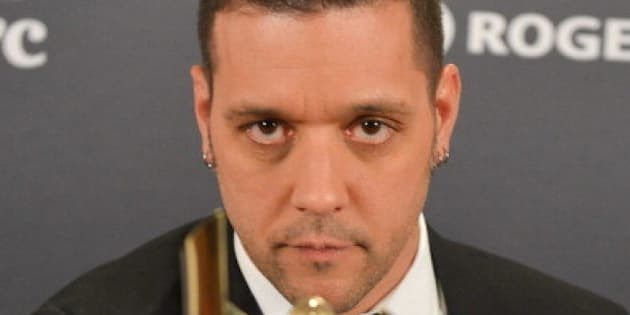 TORONTO, ON - MARCH 03:  George Stroumboulopoulos, winner for the shaw media award for best host in a variety, lifestyle,reality/compettition, performing arts or talk program or series; poses in the press room at the 2013 Canadian Screen Awards at Sony Centre for the Performing Arts on March 3, 2013 in Toronto, Canada.  (Photo by George Pimentel/Getty Images)