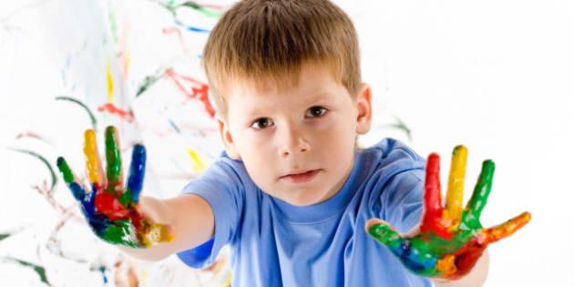 little boy draws bright colors