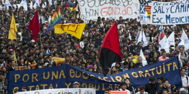 Students march during a protest to demand Chilean President Sebastian Pinera's government to improve the public education quality, in Santiago, on April 11,2013.AFP PHOTO/MARTIN BERNETTI        (Photo credit should read MARTIN BERNETTI/AFP/Getty Images)