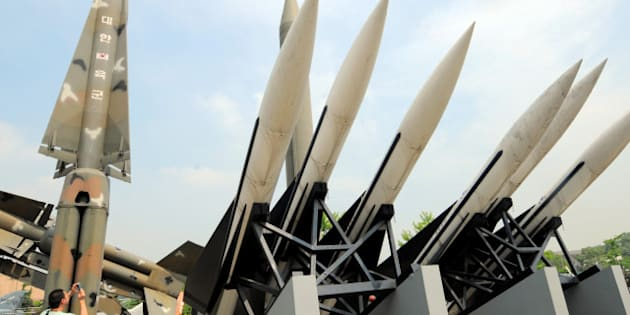 A visitor takes pictures of replicas of North Korea's Scud-B missile, (center green) and South Korean missiles that are displayed at the Korean War Memorial in Seoul on June 28, 2010. North Korea said it would bolster its nuclear weaponry with an unspecified new method in response to what it called US hostility and recent developments.  AFP PHOTO / PARK JI-HWAN (Photo credit should read PARK JI-HWAN/AFP/Getty Images)