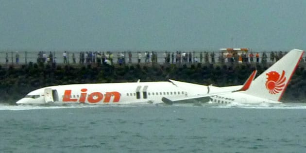A Lion Air Boeing 737 lies submerged in the water after skidding off the runaway during landing at Bali's international airport near Denpasar on April 13, 2013. An Indonesian plane carrying more than 100 passengers broke in two after missing the runway at Bali airport on April 13 and landing in the sea, leaving dozens injured but no fatalities.  AFP PHOTO/Karna Surya Putra        (Photo credit should read Karna Surya Putra/AFP/Getty Images)
