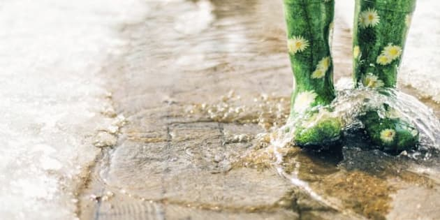 Gumboots in a puddle in the spring. Bokeh. Vignetting. shallow depth of field.