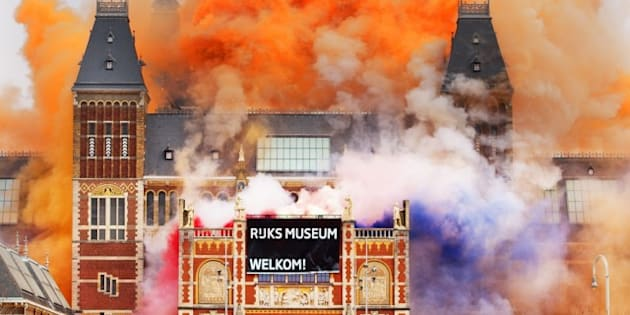 A marching band plays as fireworks are ignited at the Rijksmuseum in Amsterdam during the official re-opening of the Rijksmuseum in Amsterdam on April 13, 2013. The museum opens its doors to the public after a vast 10-year renovation aimed at breathing new life into its unparallelled collection of Golden Age masterpieces. AFP PHOTO / ANP / ROBIN UTRECHT  --NETHERLANDS OUT--        (Photo credit should read ROBIN UTRECHT/AFP/Getty Images)