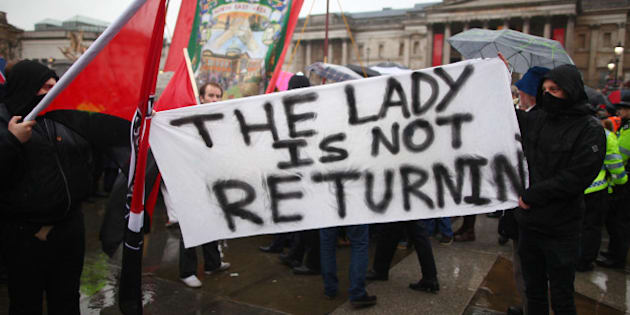 LONDON, ENGLAND - APRIL 13:  Protesters hold a sign saying 'The Lady Is Not Returning' during a party held in Trafalgar Square following the death of the former British Prime Minister Margaret Thatcher on April 13, 2013 in London, England. Downing Street announced that the funeral of former Prime Minister Baroness Thatcher will take place at London's St Paul's Cathedral on April 17.  (Photo by Jordan Mansfield/Getty Images)