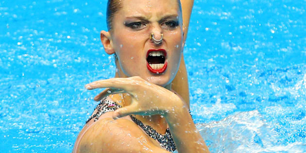 DELHI, INDIA - OCTOBER 07:  Chloe Isaac of Canada  performs prior to the Solo Free Routine at the Dr.S.P. Mukherjee Aquatics Complex during day four of the Delhi 2010 Commonwealth Games on October 7, 2010 in Delhi, India.  (Photo by Ian Walton/Getty Images)