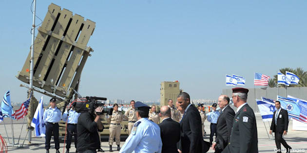 US President Barack Obama is shown an Iron Dome missile battery on March 20, 2013, at Ben Gurion International Airport on the outskirts of Tel Aviv. Obama landed in Israel for the first time as US president, on a mission to ease past tensions with his hosts and hoping to paper over differences on handling Iran's nuclear threat.  AFP PHOTO/Mandel NGAN        (Photo credit should read MANDEL NGAN/AFP/Getty Images)
