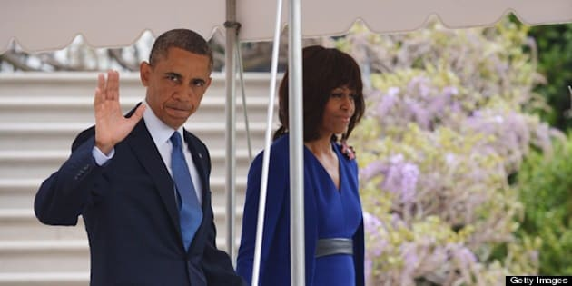 US President Barack Obama and First Lady Michelle Obama make their way across the South Lawn to board Marine One on April 18, 2013 at the White House in Washington, DC. Obama was headed to Boston for a memorial service honoring victims of the April 15 Boston Marathon bombings.    AFP PHOTO/Mandel NGAN        (Photo credit should read MANDEL NGAN/AFP/Getty Images)