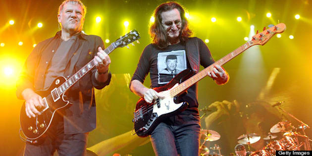 SAN JOSE, CA - NOVEMBER 15: (L - R) Alex Lifeson, Geddy Lee, and Neil Peart of Rush perform part of the bands' Clockwork Angels Tour at HP Pavilion on November 15, 2012 in San Jose, California. (Photo by Tim Mosenfelder/Getty Images)