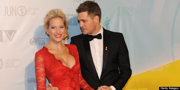 REGINA, SK - APRIL 21:  Singer and host of the 2013 Juno Awards Michael Buble and his wife Luisana Lopilato arrive on the red carpet at the Brandt Centre on April 21, 2013 in Regina, Canada.  (Photo by Jag Gundu/Getty Images)
