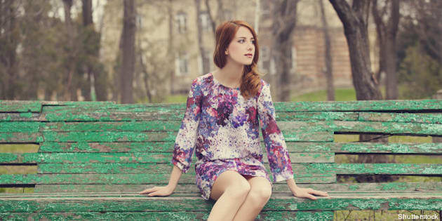 style redhead girl sitting on...