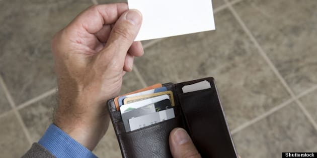 man holding his wallet and...