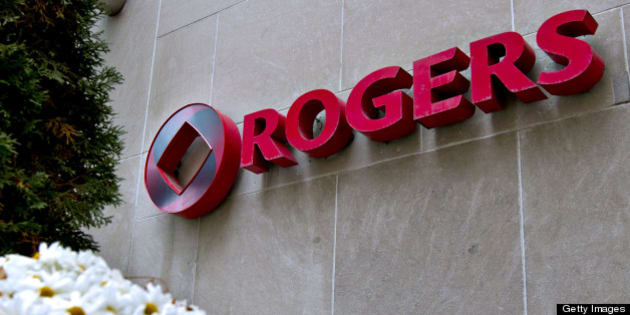 The Rogers logo sits on display outside the company's headquarters building in Toronto, Ontario, Canada, on Tuesday, Oct. 26, 2010. Rogers Communications Inc., Canada's largest wireless carrier, said third-quarter profit declined 24 percent as it added fewer subscribers and spent more on current customers' phone upgrades. The stock slumped as net income dropped to C$370 million. Photographer: Norm Betts/Bloomberg via Getty Images