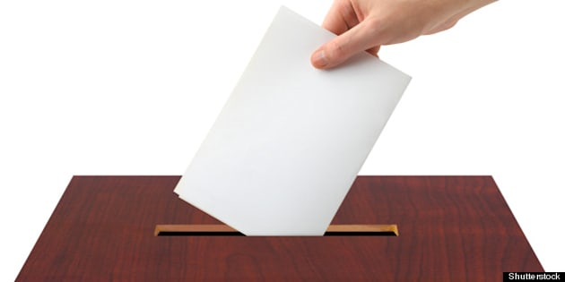 hand with ballot and box...