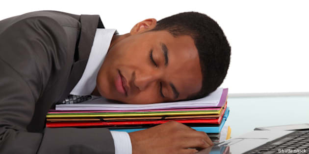 worker sleeping on a stack of...