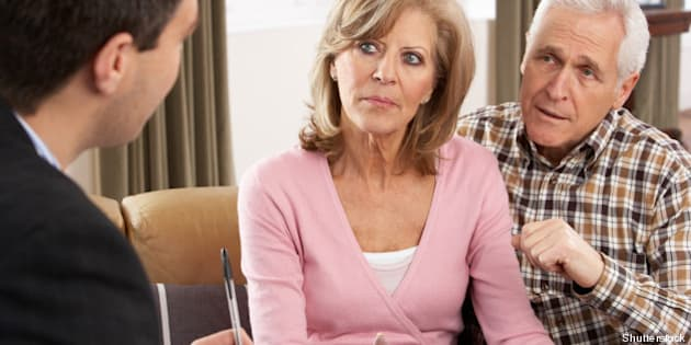 senior couple talking with...