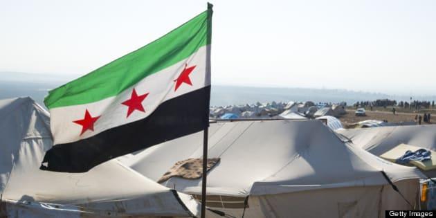 Free Syrian flag flying inside Atimah (Qatma) refugee camp, Syria