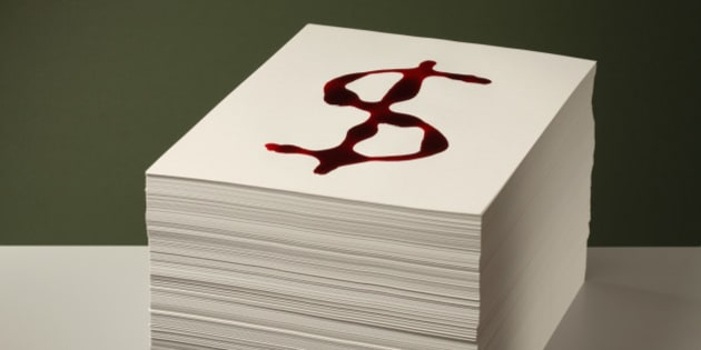Bloody Dollar sign on Paper Stack