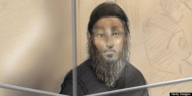 This courtroom sketch shows Raed Jaser appearing in court in Toronto on April 23, 2013. Two foreign nationals arrested on suspicion of what police say was an Al-Qaeda-backed plot to derail a Canadian passenger train in the Toronto area made their first court appearances Tuesday. Chiheb Esseghaier, 30, and Raed Jaser, 35, were arrested for allegedly planning to carry out an attack on a Via Rail train, the Royal Canadian Mounted Police told a news conference. The pair have been charged with conspiring to carry out an attack and conspiring with a terrorist group to murder persons, though very few details about the alleged plot have so far been revealed. AFP PHOTO/Alexandra NEWBOULD        (Photo credit should read ALEXANDRA NEWBOULD/AFP/Getty Images)