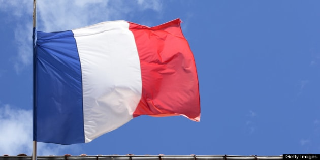 French national flag flying in front of a Government building in Paris.
