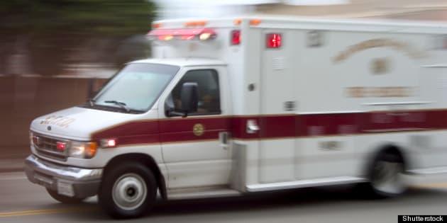 an ambulance blazes by  it's...