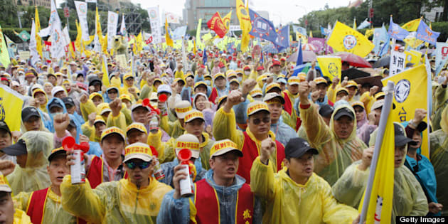 TAIPEI, TAIWAN - MAY 01:  Over 20,000 workers stage a protest against President Ma Ying-jeou's pension reforms on Labor Day on May 1, 2013 in Taipei, Taiwan. The government's cabinet recently passed bills for restructuring various pension plans. (Photo by Ashley Pon/Getty Images)