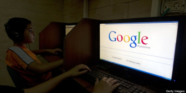 A Palestinian boy opens the Palestinian homepage of Google's search engine reading 'Palestine' at an internet cafe in east Jerusalem on May 3, 2013. Internet giant Google has recognised the Palestinians' upgraded UN status, placing the name 'Palestine' on its search engine instead of 'Palestinian Territories,' the US company said, raising the ire of Israel. AFP PHOTO/AHMAD GHARABLI        (Photo credit should read AHMAD GHARABLI/AFP/Getty Images)
