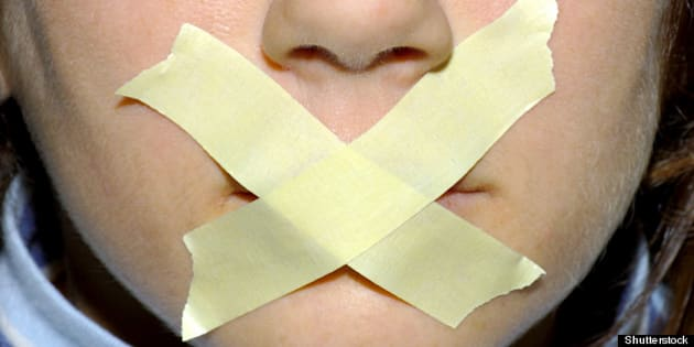 woman with tape on her mouth.