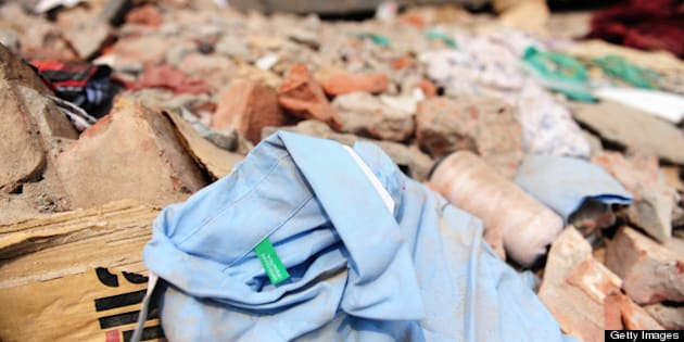 A shirt with a Benetton label lies in the rubble three days after a Bangladeshi garment eight-storey building collapsed in Savar, on the outskirts of Dhaka, on April 27, 2013. Police arrested two textile bosses over a Bangladeshi factory disaster as the death toll climbed to 332 and distraught relatives lashed out at rescuers trying to detect signs of life. AFP PHOTO/ Munir uz ZAMAN        (Photo credit should read MUNIR UZ ZAMAN/AFP/Getty Images)