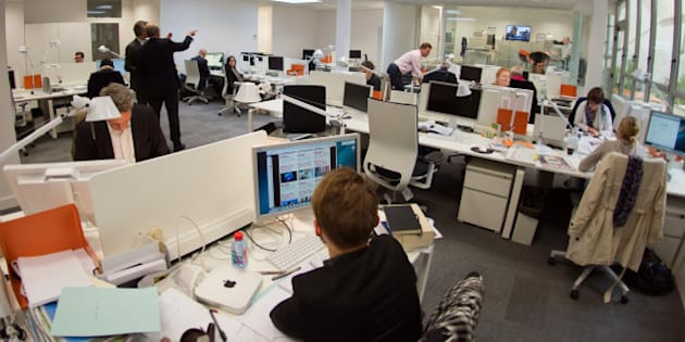Journalists work inside the newsroom of new French media company 'L'Opinion', which aims to be a daily online newspaper also sold in print form five days a week, as well as an online news app and a webtv, in Paris, on May 6, 2013. The launch of the new newspaper will be on May 14, according to the CEO.  AFP PHOTO / LIONEL BONAVENTURE        (Photo credit should read LIONEL BONAVENTURE/AFP/Getty Images)
