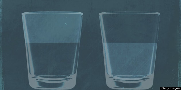 A half full glass of water next to a half empty glass of water