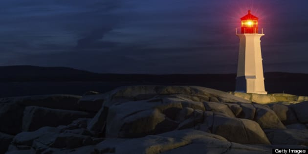 Comet Pan-STARRS hangs in deep twilight over Peggy's Cove Lighthouse.  Long exposure at high iso.