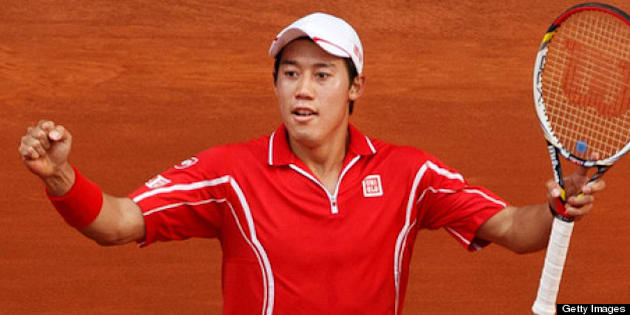 MADRID, SPAIN - MAY 09:  Kei Nishikori of Japan celebrates matchpoint after winning his match against Roger Federer of Switzerland on day six of the Mutua Madrid Open tennis tournament at the Caja Magica on May 9, 2013 in Madrid, Spain.  (Photo by Jasper Juinen/Getty Images)