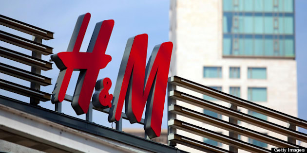 The H&M logo sits above a store operated by Hennes & Mauritz AB (H&M) in Berlin, Germany, on Thursday, April 18, 2013. Germany's economy is shrugging off a contraction at the end of last year and starting to grow due to revived exports and rising private consumption, the country's leading economic institutes said. Photographer: Krisztian Bocsi/Bloomberg via Getty Images