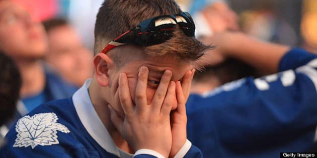 TORONTO, ON - MAY 8:  A Toronto Maple Leaf fan reacts after a Boston goal outside the Air Canada Centre the Toronto Maple Leafs play the Boston Bruins.        (Carlos Osorio/Toronto Star via Getty Images)