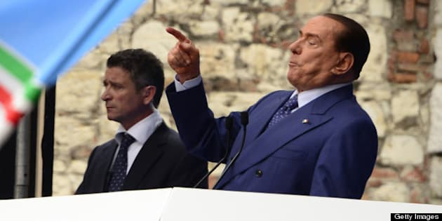 Italian former Prime Minister Silvio Berlusconi delivers a speech during a rally organised by the People of Freedom party (PDL) against 'politicised magistrates' on May 11, 2013 in Brescia, after a four-year prison sentence and a three-year amnesty was confirmed against Berlusconi convicted for tax fraud. A loudmouth in elections earlier this year, Silvio Berlusconi has been understated since then, as he seeks a statesman-like image marked by his surprisingly muted reaction to a court ruling that upheld his conviction for tax fraud.  AFP PHOTO / OLIVIER MORIN        (Photo credit should read OLIVIER MORIN/AFP/Getty Images)